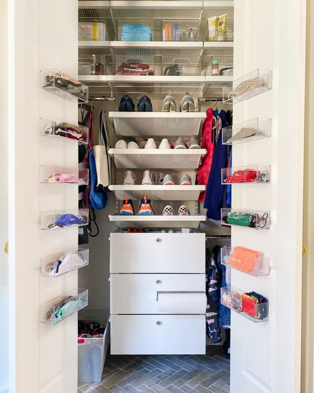 This mudroom closet is reporting for duty!   Adhesive acrylic cups on the inside of the closet doors make for an easy grab-and-go mask station. ⠀⠀⠀⠀⠀⠀⠀⠀⠀ Settled CLOSETS ™️ ⠀⠀⠀⠀⠀⠀⠀⠀⠀ #settled #homeorganization #mudroom #closet #maskorganization #mudroomdesign #closetinspo #organizedlifestyle #shoeorganizer #organization #homeentrance #nomoreclutter #whatsinside #customhomes #homedecor #organization #home #organizedhome #pictureperfect #settledsystems