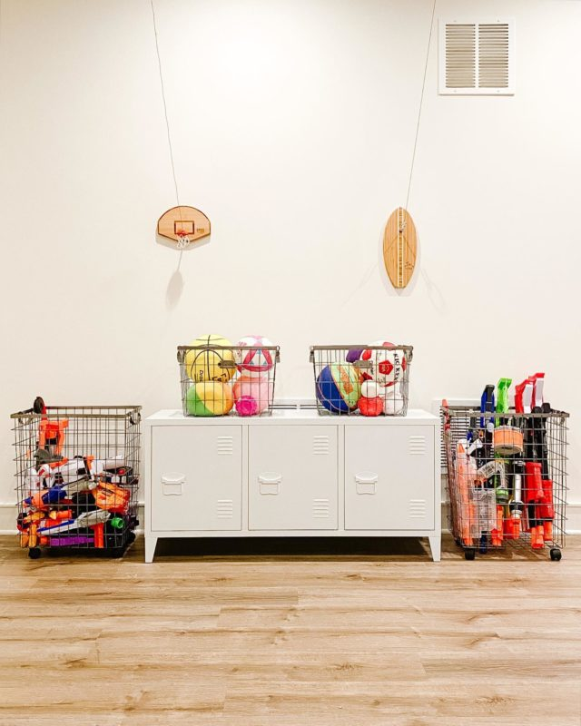Once a forgotten wall, now a fun and functional Nerf storage system. We love this locker-room-chic vibe!  Settled KiDS ™️  #homeorganization #playroom #nerf #gameroom #kidsdecor #kidsroomorganization #nerfgun #nerfnation #organizedlife #toyorganization